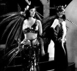 Birds of a feather? Trixie and Satan trade jokes.