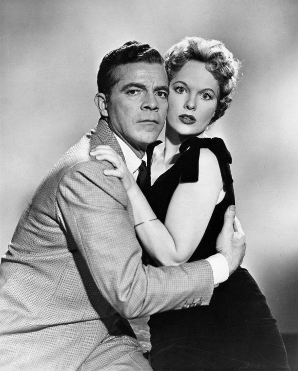 night-of-the-demon-1957-005-publicity-shot-dana-andrews-clinging-to-peggy-cummins-00m-fam